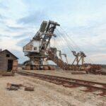 Broken rusty giant quarry excavator
