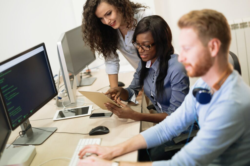 Programmers cooperating at information technology company